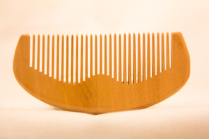 apply beard oil with a beard comb